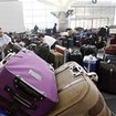 JFK Airport Workers Stole From Baggage, Queens DA Says