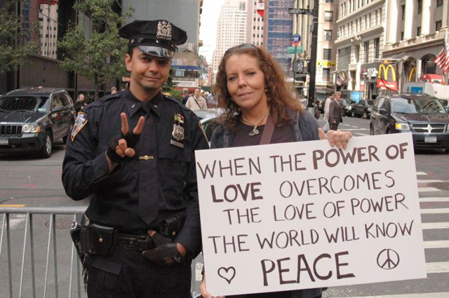 Some Cops Furious NYPD Officer Flashed Peace Sign In Photo With Occupy Wall Street Protester
