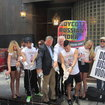 Models Wearing Georgi Vodka Shirts Pour Out Latvian Booze To Protest Putin