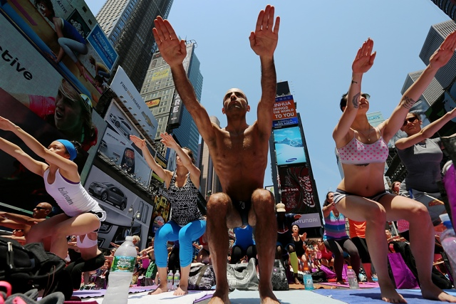 Summer Solstice Yoga Takes Over Times Square On Saturday