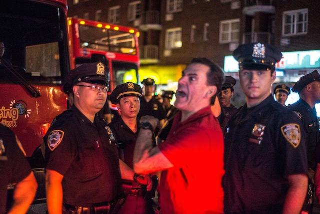 Photos: Man Dining In Chelsea Angrily Confronts Garner Protesters