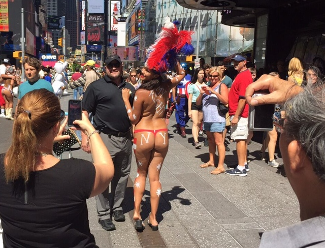 Topless Painted Women Get Times Square Welcome From Tourists, NY State Police