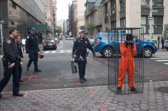 Photos: Artist Locks Himself In Cage In Front Of Manhattan Jail To Protest Prison System