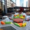 NYC\'s Newest Rooftop Bar Has Rainbow Decor, Movie Screenings & Hawaiian Pizza