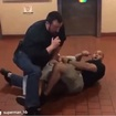 Cop Stripped Of Gun, Badge After Video Shows Him Pointing Gun At & Punching Bystanders