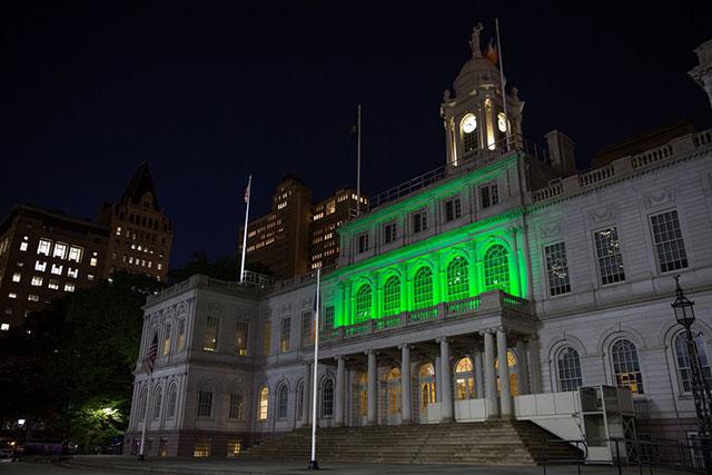 City Hall, 1 World Trade Center, Kosciuszko Bridge Lit In Green To Support Paris Accord