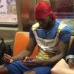 Subway Rider Solves Rubik's Cube With One Hand, Impressing No One