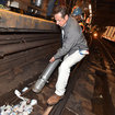 Macho Cuomo Climbs Down Onto Filthy Subway Tracks With A Vacuum, Doubles Fines For Littering