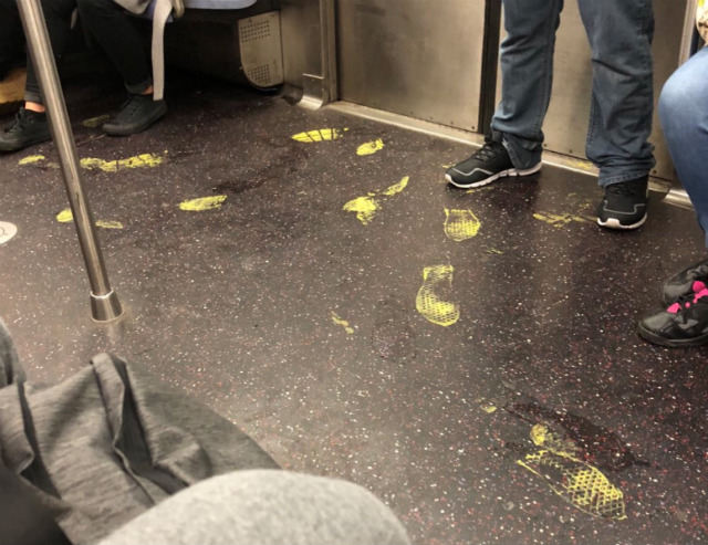 Those Yellow Footprints Are Still On The C Train Over Three Months Later