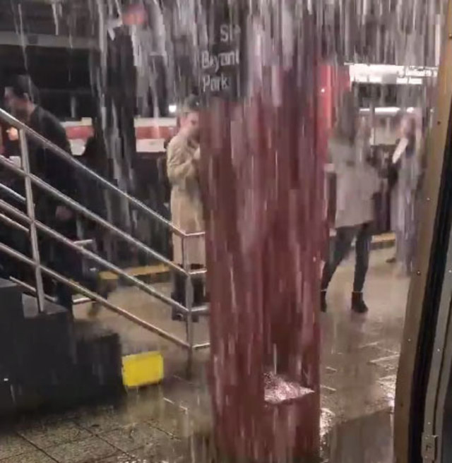 NYers Chase Subway Waterfalls & Brave Train Rain During Nasty Monday Commute