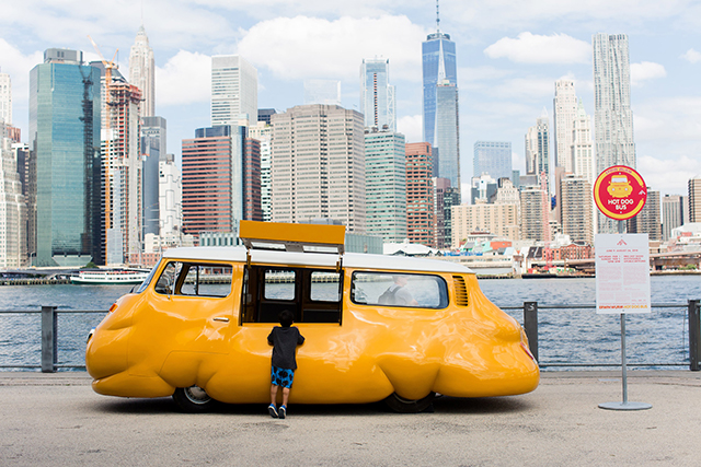 This Misshapen VW Bus Is Bringing Free Hot Dogs & Guilt To Brooklyn Bridge Park