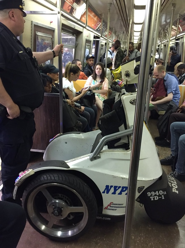 Cop Brings NYPD Scooter On Rush Hour Subway Train
