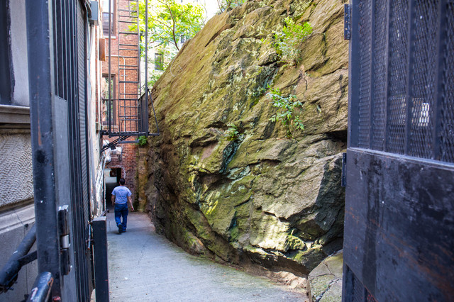 This Gigantic Rock Jammed Between Two Buildings Is A Huge Part Of NYC History