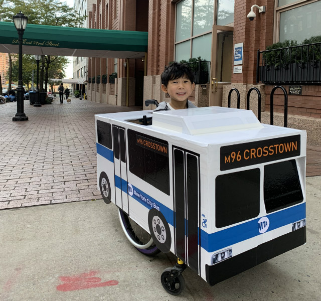 This Boy In A Homemade MTA Bus Had The Most Heartwarming Halloween Costume In NYC