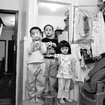 Photographer Thomas Holton Has Spent 15 Years Documenting One Family Living In A Tiny Chinatown Apartment