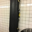 Say, What's Up With This Gun Case Mounted To The Walls Of This Subway Platform?