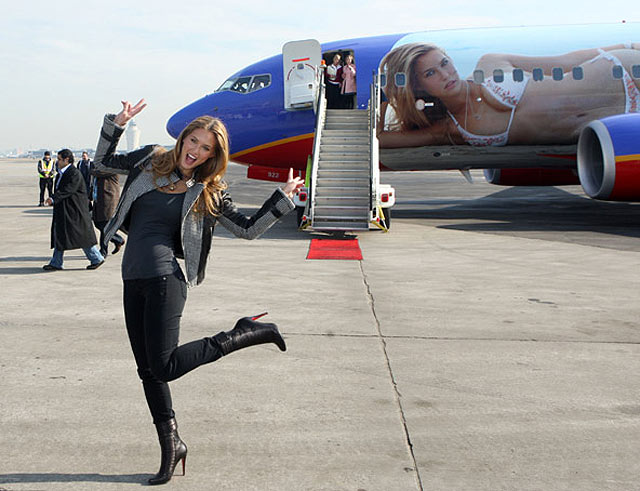 Lara Logan Swimsuit: Bar Refaeli in front of the Southwest Airlines plane