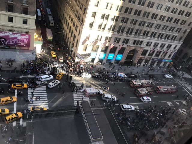 Pedestrians run down outside New York's Penn Station