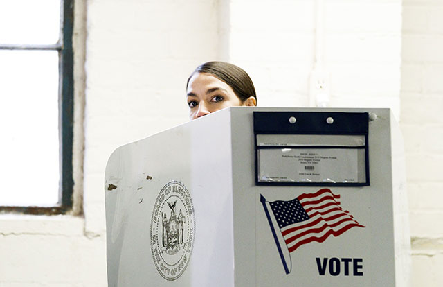 Alexandria Ocasio Cortez votes in her district in the Bronx