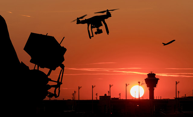Drone sightings briefly halt traffic at US airport