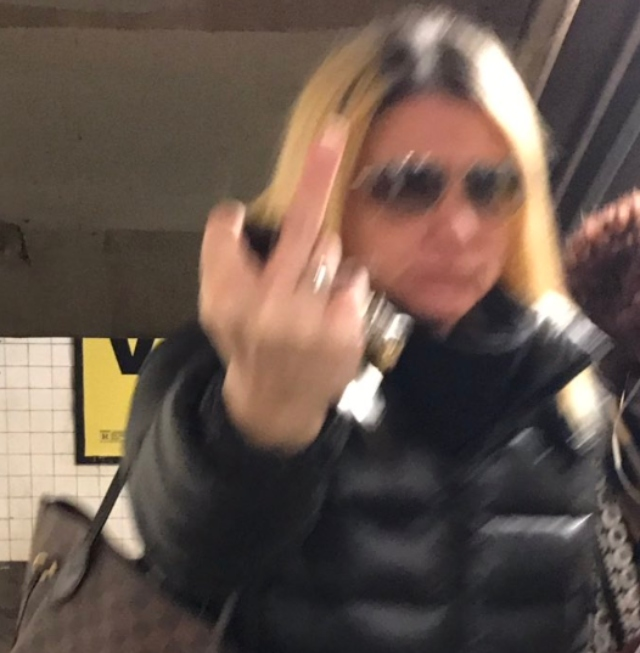 Woman arrested after video shows her attacking subway rider, using racial slur