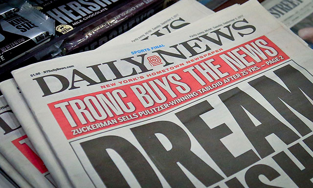New York Daily News axes half of its staff