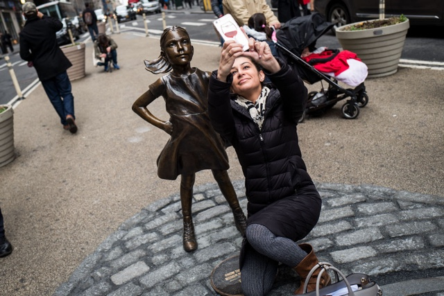 Firm behind 'Fearless Girl' statue OKs equal pay settlement